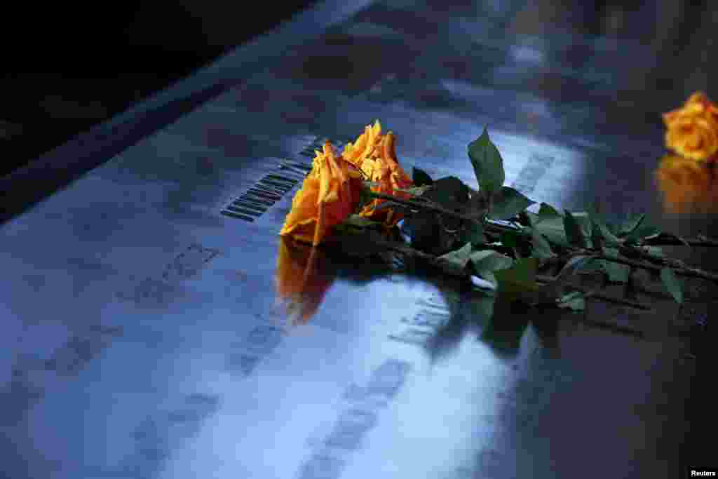 Flowers are seen on the reflecting pool of the 9/11 Memorial during a commemoration ceremony marking the 23rd anniversary of the 1993 World Trade Center bombing in New York.