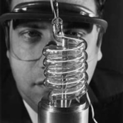 Theodore Maiman with parts of the first laser at Hughes Research Laboratories