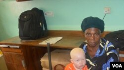Enipher Foster of Chiradzulu district says the kidnappings has forced her to carry her granddaughter whereever she goes. (Lameck Masina for VOA News)