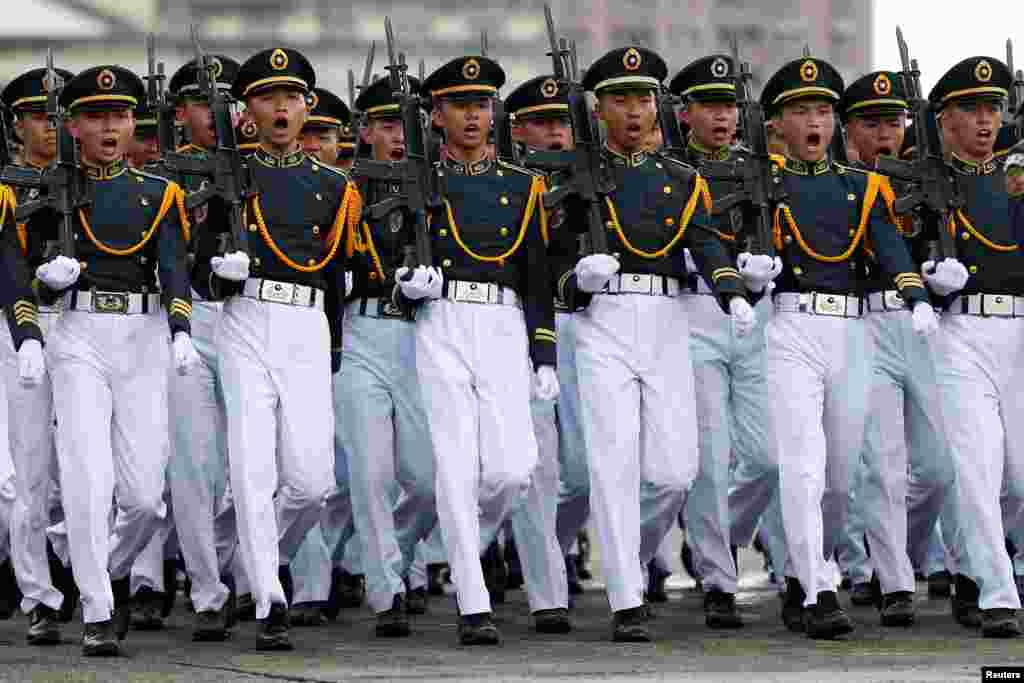 Taiwanese cadets march during a ceremony to mark the 92nd anniversary of the Whampoa Military Academy, in Kaohsiung, southern Taiwan.