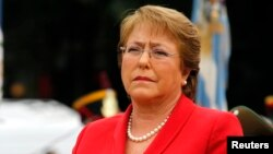 FILE- Chile's President Michelle Bachelet applauds as she attends a wreath-laying ceremony in Buenos Aires, Argentina, May 12, 2014.