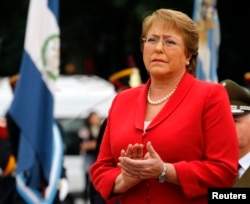 FILE - Chile's President Michelle Bachelet applauds as she attends a wreath-laying ceremony in Buenos Aires, May 12, 2014.