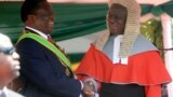 FILE: Zimbabwean President Emmerson Mnangagwa,left, is congratulated by Chief Justice Luke Malaba after taking his oath during his inauguration ceremony at the National Sports Stadium in Harare, Sunday, Aug. 26, 2018.