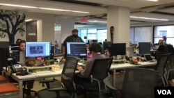 Employees at GlobalGiving at its Washington, D.C., office keep the world's first and largest crowdfunding organization open year round. It operates virtually 24/7. (Photo - C. Presutti/VOA).