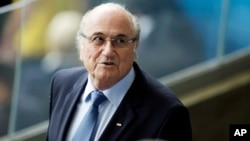 FILE - Fifa President Sepp Blatter waits for the beginning of the World Cup semifinal soccer match between Brazil and Germany at the Mineirao Stadium in Belo Horizonte, Brazil, July 8, 2014.