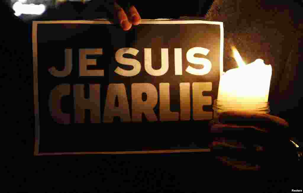 "A person holds a placard that reads ""I am Charlie"" to pay tribute during a gathering in Strasbourg, France, following a shooting by terrorists at the offices of the weekly satirical Charlie Hebdo in Paris, Jan. 7, 2015."