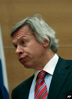 """FILE - Senior Russian lawmaker Alexey Pushkov, seen speaking in parliament in May 2013, sees Brexit as reflecting a """"crisis in the EU governance model"""" and calls it a """"personal failure"""" for President Barack Obama."""