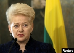 resident of Lithuania Dalia Grybauskaite addresses the media during a news conference in Riga, Latvia, Feb. 9, 2017.