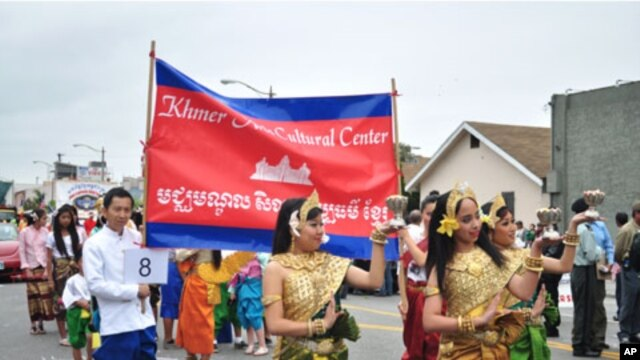 Cambodian traditional dancers give blessing during an annual parade in the designated 'Cambodia Town' section of Long Beach, California, on April 2, 2011, to celebrate Khmer New Year.