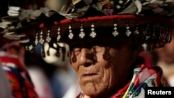 FILE - A Huichol elder, wearing a traditional hat, takes part in a protest in Mexico City, Oct. 27, 2011, against the construction of a silver mine in Wirikuta, one of the Huichol indigenous community's sacred ceremonial sites.