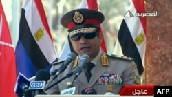 "FILE - An image grab taken from Egyptian state TV shows Egypt's army chief General Abdel Fattah al-Sisi giving a live broadcast calling for public rallies to give him a mandate to fight ""terrorism and violence."""