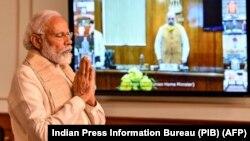 印度總理莫迪在新德里舉行內閣成員視頻會議時為中印邊界衝突中喪生的印度士兵默哀兩分鐘。(2020年6月17日)