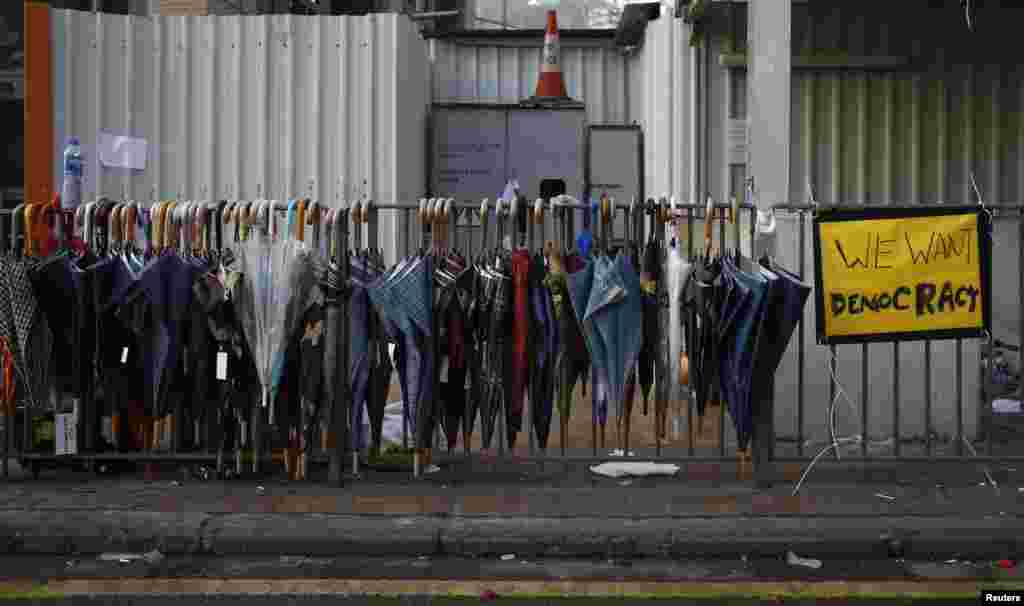 Umbrellas used by protesters hang at a site near the main road leading to the financial Central district in Hong Kong, Sept. 30, 2014.