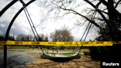 A children's playground is closed with caution tape amid the coronavirus disease (COVID-19) outbreak in Seattle, Washington, U.S., March 24, 2020. (REUTERS/Brian Snyder)