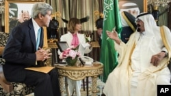 U.S. Secretary of State John Kerry, left, and King Abdullah wait for a meeting at the King's private residence in the Red Sea city of Jeddah, Saudi Arabia, June 27, 2014
