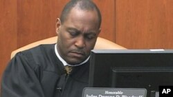 Judge Dwayne Woodruff hands down rulings from the bench in Pittsburgh, Pennsylvania's Juvenile Court