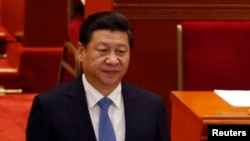 China's President Xi Jinping arrives at the closing ceremony of the Chinese People's Political Consultative Conference at the Great Hall of the People in Beijing, Mar. 12, 2014.