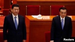 2014年3月12日,中國國家主席習近平(左)出席中國政協十二屆二次會議閉幕會