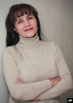 """FILE - Uzbek film director Umida Akhmedova, pictured in Tashkent in November 2009, has been accused of slander and """"damaging the country's image"""" for publishing a series of photos about life in rural parts of Uzbekistan."""