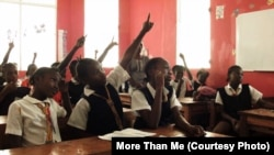 Students seek attention at the More Than Me Academy in Monrovia, Liberia.