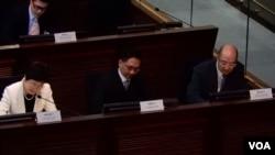港府政改三人組(左起)林鄭月娥、袁國強、譚志源,出席立法會政制事務委員會會議,就政改報告接受議員質詢