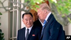 FILE - President Donald Trump talks with Kim Yong Chol, former North Korean military intelligence chief and one of leader Kim Jong Un's closest aides, as they walk from their meeting in the Oval Office of the White House in Washington, June 1, 2018.