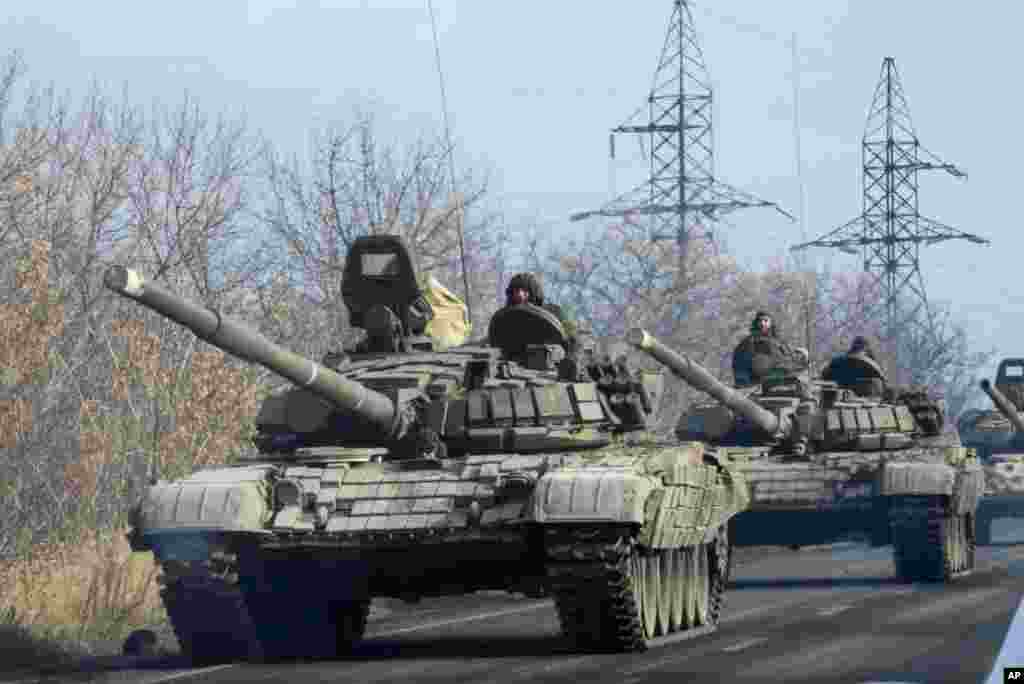 Pro-Russian rebel military vehicles move towards Donetsk, eastern Ukraine, Nov. 10, 2014.