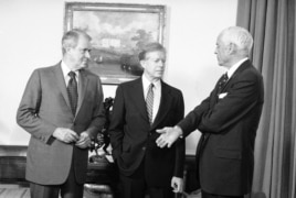 FILE - U.S. Ambassador to the USSR, Thomas Watson (R), who was recalled consultation after the Soviet military intervention in Afghanistan, talks with President Jimmy Carter and Secretary of State Cyrus Vance (L) at the White House in Washington, Jan. 5, 1980.