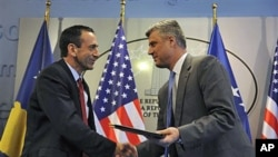 U.S Assistant Secretary of State Philip Gordon shakes hand with Kosovo Prime Minister Hashim Thaci (R) after signing an agreement to support education authorities in capital Pristina, June 16, 2011