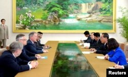 Vice Premier and Minister of Agriculture Ko In Ho meets David Beasley, U.N. World Food Programme's Executive Director, in this undated photo released by N. Korea's Korean Central News Agency (KCNA) in Pyongyang, May 11, 2018.