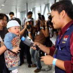 A baby arriving from Japan receives nuclear radiation detection from at Kuala Lumpur International Airport in Sepang, Malaysia.