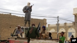 Fighters from Islamist group Ansar Dine stand guard in Timbuktu, Mali. (file)
