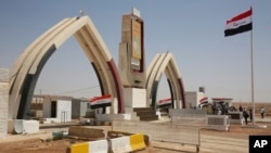 Iraqi flags fly at the recently opened Iraqi Trebil border crossing on the Iraq-Jordan border, Aug. 30, 2017.