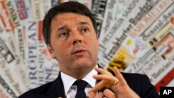 Italian Premier Matteo Renzi listens to a reporter's question during a press conference at Rome's foreign press association, Feb. 22, 2106.