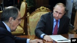 FILE - Russian President Vladimir Putin, right, listens to Russian Foreign Minister Sergey Lavrov during their meeting in the Kremlin in Moscow, Russia, March 14, 2016.