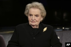"FILE - Former U.S. Secretary of State Madeleine Albright is seen during an interview in New York, March 2, 2016. Albright says the United States ""will need all the help we can get to repair the damage he [Donald Trump] is doing to our country's international reputation and interests."""