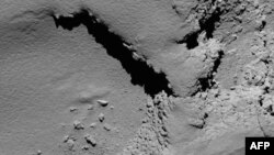 A handout picture released on Sept. 30, 2016 by the European Space Agency (ESA) shows a view taken by Rosetta's OSIRIS narrow-angle camera of Comet 67P/Churyumov-Gerasimenko at 08:18 GMT from an altitude of about 5,8 km during the spacecraft's final descent on Sept. 30.