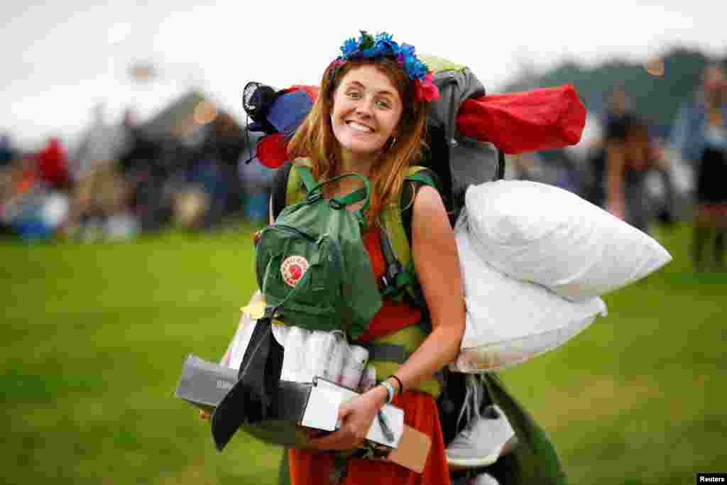 A reveler arrives for Glastonbury Festival at Worthy farm in Somerset, Britain.