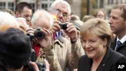 German chancellor Angela Merkel arrives for celebrations marking the 20th anniversary of Germany's reunification in Bremen, northern Germany, Sunday Oct. 3, 2010
