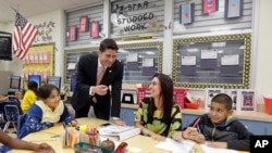 House Speaker Paul Ryan of Wis., talks to third grade Language Arts/Reading teacher Nadia Lorenzo-Luis during a visit atto Caribbean Elementary School, Wednesday, Oct. 19, 2016, in Miami. (AP Photo/Alan Diaz)
