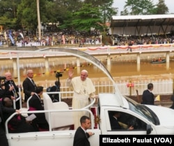 Pope Francis drove a loop around the main stage, greeting fans on all sides, before celebrating Mass in Namugongo, Uganda, Nov. 28, 2015.