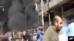 20일 시리아 다마스쿠스 인근의 전투기 추락 현장에서 검은 연기가 피어오르고 있다.
