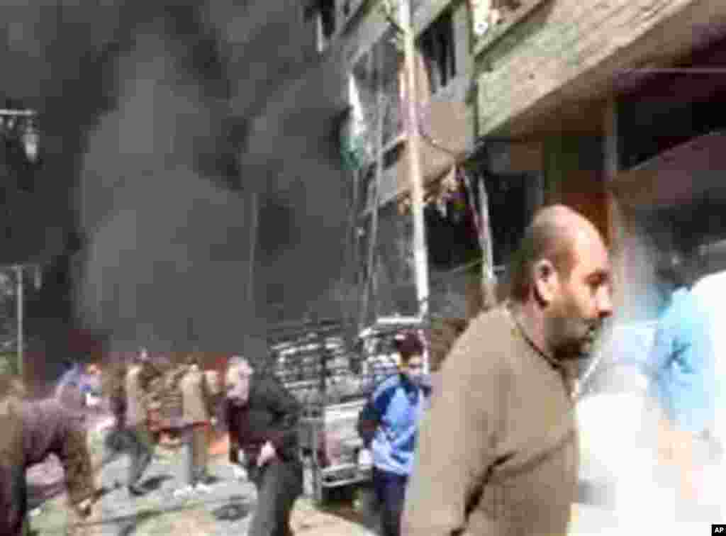 This image taken from video obtained from Ugarit News, which has been authenticated based on its contents and other AP reporting, shows smoke and fire after a fighter jet crashed into a suburb of Damascus, Syria, Wednesday, Feb. 20, 2013. The United Natio