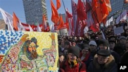 Opposition protesters with a placard depicting Czar Ivan The Terrible gathered during a rally in Moscow, Russia, March 10, 2012.