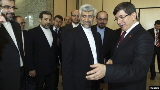 Turkey's Foreign Minister Ahmet Davutoglu [R] welcomes Iran's chief negotiator Saeed Jalili [2nd R] before their meeting in Istanbul, April 14, 2012.
