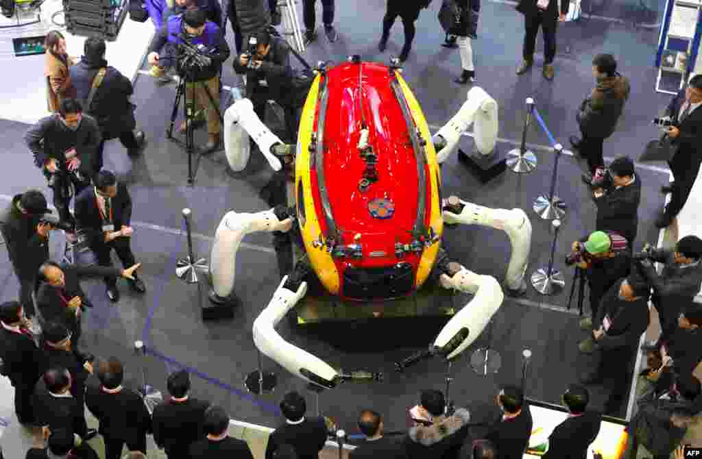 Visitors look at an undersea exploration robot during a drone show at the BEXCO Exhibition Hall in the southeastern port city of Busan, South Korea.