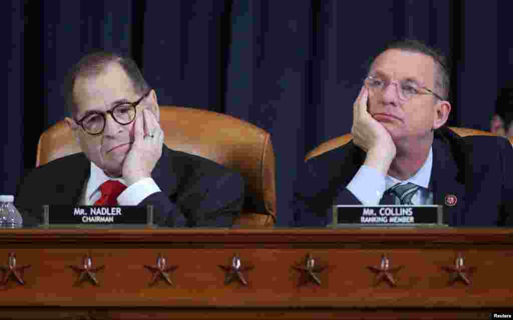 House Judiciary Committee Chairman Rep. Jerrold Nadler (D-NY) and ranking member Doug Collins (R-GA) listen to testimony as the committee holds a hearing to receive counsel presentations of evidence from the impeachment inquiry into U.S. President Donald Trump on Capitol Hill in Washington.