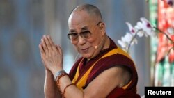 Exiled Tibetan spiritual leader, the Dalai Lama, speaks to his followers during the Jangchup Lamrim teaching session at the Gaden Jangtse Thoesam Norling Monastery in Mundgod in the southern Indian state of Karnataka, Dec.23, 2014.