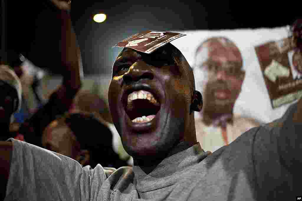 A Sall supporter celebrates in the capital Dakar, March 25, 2012. (Reuters)