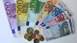 German Euro notes and coins pictured in the regional central bank in Bremen, northwest Germany, Friday, Dec. 14, 2001. On Monday, Dec. 17, the first Euro coins starter kits will start selling all over Germany. The Euro will appear as 5, 10, 20, 50, 10O, 2